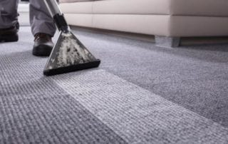 A professional carpet cleaner in action.